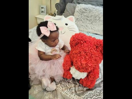 This young princess shows off her Malibrands Ja hair bow and teddy bear.