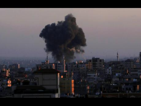 Smoke rises following Israeli airstrikes in Gaza City, yesterday.