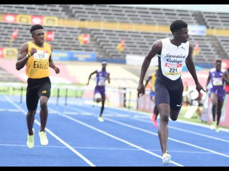 Ian Allen Javier Brown (right) from Jamaica College  crosses the finish line in of the Class One boys 400 metres hurdles final ahead of  Devontie Archer (left) from Excelsior High School in a record time of 49. 86 seconds at the ISSA/GraceKennedy Boys and