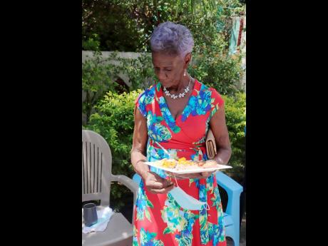 This lady in red, known to everyone in the Top Range community as Miss Brown, stood out in her dress decorated with flowers when she dropped by for her treat.