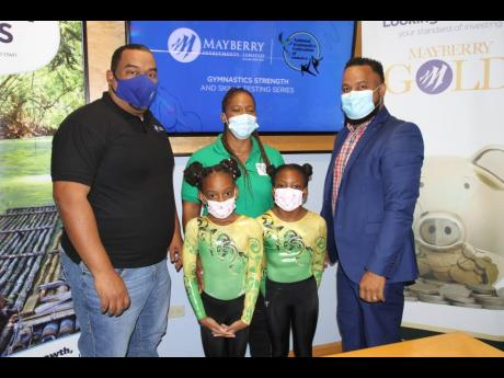 Mayberry Investments' CEO, Gary Peart (left) and Ryan Foster (right), Secretary General/CEO, Jamaica Olympic Association, flank National Gymnastics Federation President of Jamaica, Nicole Grant-Brown (centre) and gymnasts Rihanna Williams (second left) a
