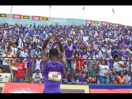 Akeem Weir of Kingston College (KC) celebrates in front of a section of the KC supporters after winning the Class Three boys 400m final at the ISSA/GraceKennedy Boys and Girls' Athletics Championships at the National Stadium on Saturday March 30, 2019.