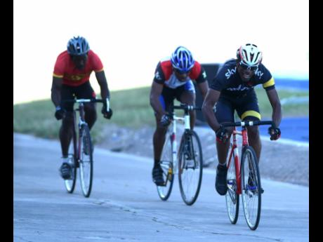 Jamaica Cycling Federation president Dr Wayne Palmer (right) leads the pack at a development meet at the National Stadium Velodrome on Sunday, February 11, 2018.