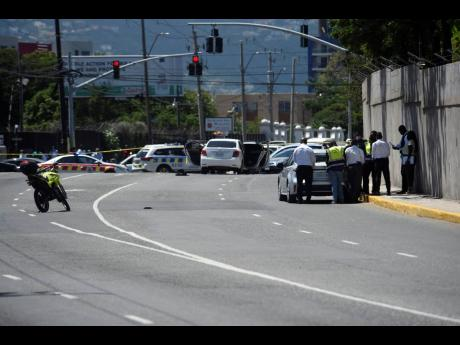 Police at the scene of the shootout at Trafalgar-Hope-Waterloo intersection where alleged killers of businessman Robert Fletcher were confronted, resulting in a fierce gun battle in traffic on Monday, May 10.