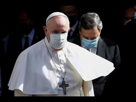 Pope Francis walks with Italian Premier Mario Draghi at a conference on the Demographic Crisis in Rome Friday, May 14.