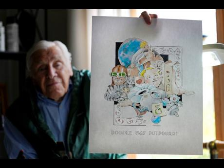 Artist Robert Seaman holds up the 365th daily doodle sketch.