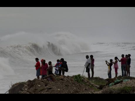 People in Kingston watch as a storm approaches in October 2016. It is the job of the ODPEM to ensure Jamaica is prepared for and able to cope with natural disasters.