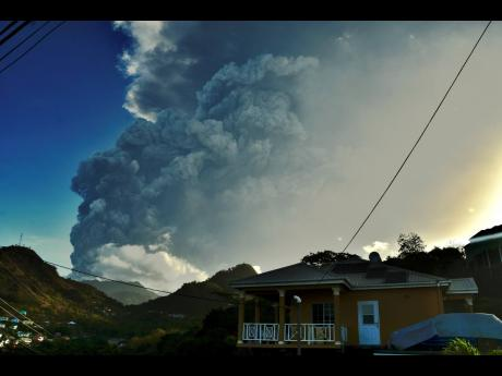 In this April 13, 2021 file photo, ash rises from the La Soufriere volcano as it erupts on the eastern Caribbean island of St Vincent. The eruptions displaced nearly 20% of the population.