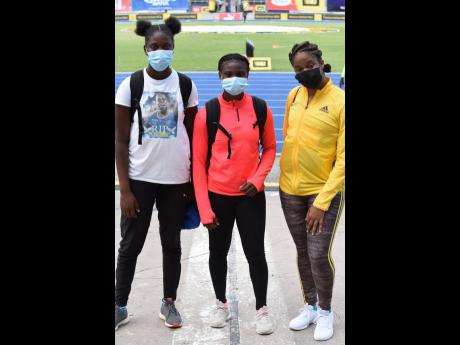 Roxene Simpson (left) and Kimola Hines (centre), from Clarendon College, were first and second in the Class One Girls discus throw final, ahead of Manchester High School's Fabrienne Foster at the ISSA/GraceKennedy Boys and Girls' Athletics Championshi