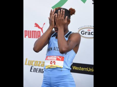 A dejected Tina Clayton, despite her victory in the Class Two Girls 100m final on Thursday. Clayton was disappointed that her twin sister Tia, who says the 100m is her favourite race, had a false start.
