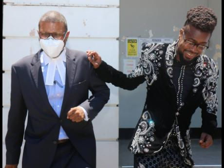 Dancehall artiste Moses 'Beenie Man' Davis (right) exits the St Elizabeth Parish Court in Black River yesterday after being fined $150,000 for breaching the Disaster Risk Management Act.