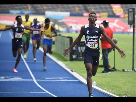 Jamaica College's  Kemarrio Bygrave (right) and his teammate Khandale Frue (left) celebrate after finishing first and second, respectively, in the Class Two 800 metres final on last Saturday's final day of  the 2021 ISSA/GraceKennedy Boys and Girls'