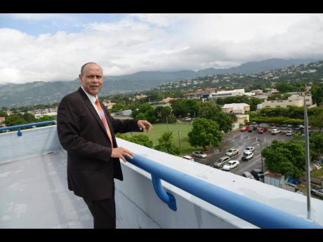 In this November 13, 2017 file photo, President of Guardian Life Limited Eric Hosin speaks about the company's plans from the rooftop of the company's New Kingston headquarters.