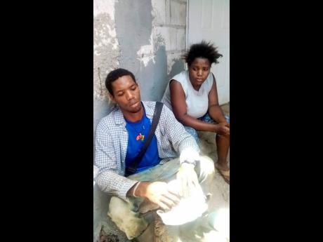 Omar Flowers and Crystal Johnson are a picture of grief, having lost their two infant sons in a fire at their home in Lilliput, St James, yesterday.