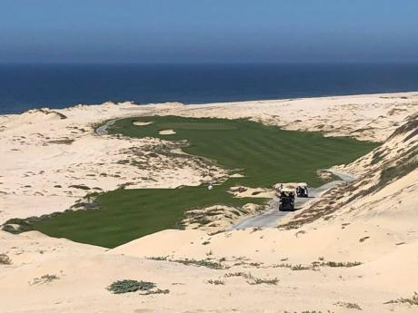 Beach sand surrounds a hole at Rancho San Lucas' Norman Course along the Pacific Ocean in Cabo San Lucas, Mexico, on February 21, 2020. Rancho San Lucas was only open three weeks before the coronavirus pandemic shut it down, but play has started to pick