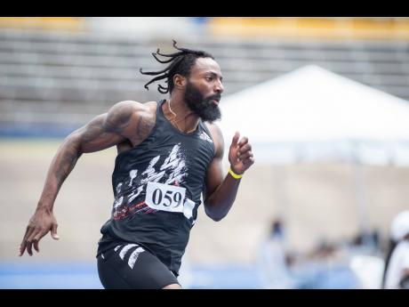 National sprinter Rasheed Dwyer in action in the men's 200m event at the JAAA Qualification Meet at the National Stadium on Saturday, April 24.