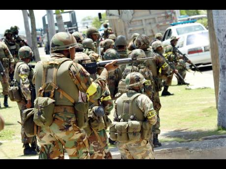 In this May 2010 photo, Jamaica Defence Force soldiers positioned at Kingston Waterfront was quite busy as they prepare to move into Tivoli Gardens and Denham Town.