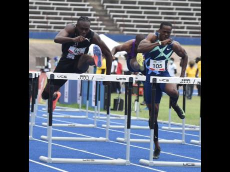Rasheed Broadbell (left) clears the final hurdle in the men's 110 metres hurdles ahead of  Ronald Levy (right) during the JOA/JAAA Olympic Destiny  Series track meet at the National Stadium yesterday. Broadbell won in 13.10 seconds.