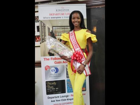 Miss Universe Jamaica Miqueal-Symone Williams arrives at the Normal Manley International Airport in Kingston last Thursday after competing at the 69th Miss Universe pageant, which was held at the Seminole Hard Rock Hotel & Casino in Hollywood, Florida, on