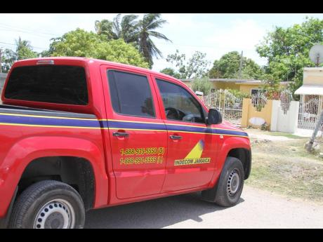 Personnel from the Independent Commission of Investigations processed the scene yesterday after a man was reportedly shot dead by his brother, a police officer, in Lionel Town, Clarendon.