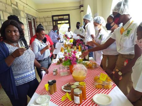 The judges and special guests sample the products manufactured by second-year students at the Knockalva Polytechnic College  in Hanover. The students are pursuing their associate degree in agro-processing and business management.