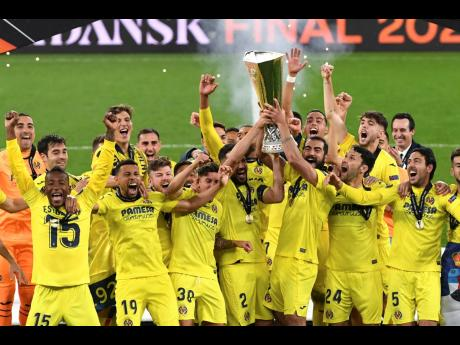 Villarreal players lift the trophy after the Europa League final match between Manchester United and Villarreal in Gdansk, Poland, yesterday.