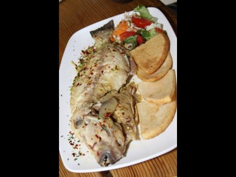 The steamed fish and fried bammy at White Sands Beach Seafood Restaurant.
