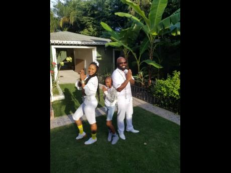 From left: Keiva Di Diva; Destiny, Keiva Di Diva's daughter; and Richie Stephens strike the famous Charlie's Angels' pose.