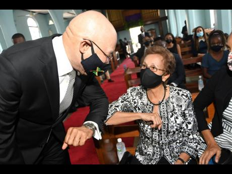 Pamela Johnson (right), widow of the late Ambassador Anthony Johnson greets Sir Patrick Allen, governor general of Jamaica.