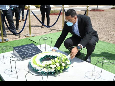 Prime Minister Andrew Holness paying tribute to former Prime Minister Edward Seaga at the National Heroes Park yesterday.