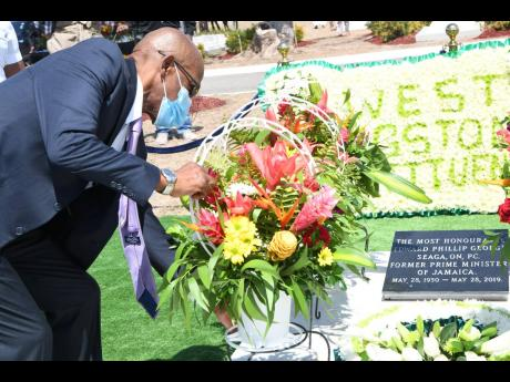 Christopher Seaga, son of the late Edward Seaga, lays wreath during a commemorative ceremony for the 91st anniversary of the birth of the former prime minister at the National Heroes Park in Kingston on Friday, May 28.