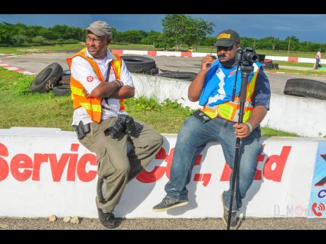 March (right) and Donovan Montague taking a quick rest, at a racing track.