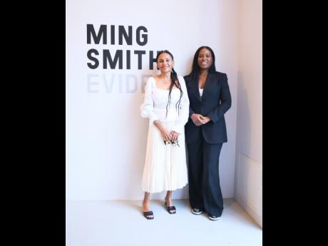 Nicola Vassell (right) opened her art gallery with the intriguing work of pioneer female photographer, Ming Smith.