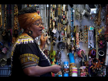 Billie Parker, owner of the Black Wall Street Market, displays some of the items she has for sale in Tulsa. Her establishment, in an underdeveloped and underserved section of the city, is a far cry from the booming city within a city that was Greenwood, wi