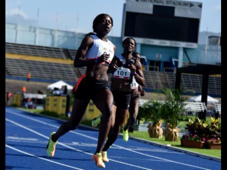 Shericka Jackson wins the women's 100m dash at the JOA/JAAA Olympic Destiny Series at the National Stadium yesterday.