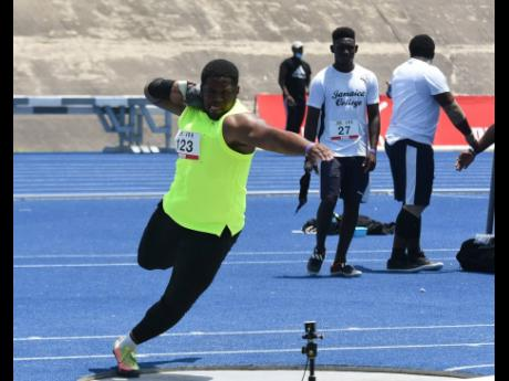 O'Dayne Richards wins the men's shot put with a distance of 19.85m at the JOA/JAAA Olympic Destiny Series at the National Stadium yesterday.