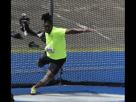 Fedrick Dacres on his way to victory in the men's discus throw event at the Olympic Destiny Series at the National Stadium yesterday.