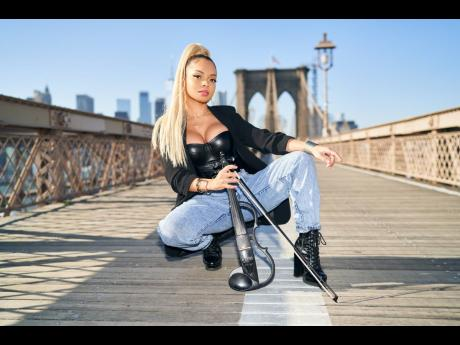 Volinist Mapy commands the same attention on stage as she does in the middle of the Brooklyn Bridge, posing for US-based photographer Rious.