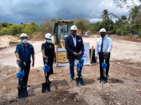 From left: Mayor of May Pen Winston Maragh; councillor for the Palmers Cross Division, Carlene Benjamin; Paul Walker of Halton Development Management; and Pearnel Charles Jr, housing minister and member of parliament for Clarendon South East, break ground
