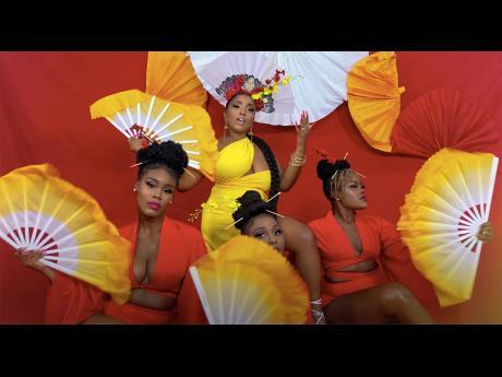 Dancers Catherine 'Cat King Cole' Reid, Kimiko 'Kimiko Versatile' Miller and Shereda 'Reda Versatile' McEwan are a picture of Asian persuasion for Tia's 'Fahrenheit' music video.