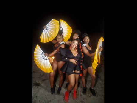 Reggae singer Tia is flanked by dancers (from left), Kimiko Versatile, Cat King Cole and Reda Versatile.