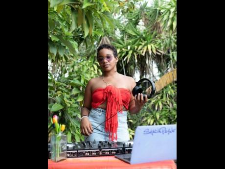 DJ Shacia Payne gets her head into the game for the music video.