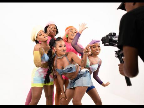Recording artiste Amanyea (centre) is feeling the energy of her dancing cohorts Kara Lee, Catherine Reid, Toni 'Happy Feet' O'Meally, and Shamara 'Inspire' Spencer.