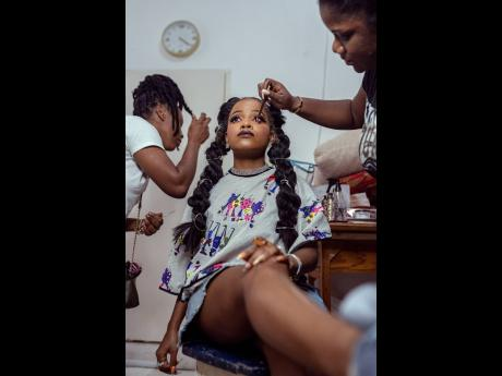 Amanyea tries to stay still as Nyoka Gregory and Ash Beauty Studios put the finishing touches to their live canvas.