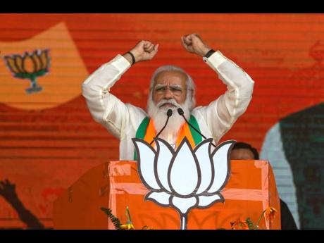 In this March 7, 2021 photo, Indian Prime Minister Narendra Modi addresses a public rally ahead of West Bengal state elections in Kolkata, India.