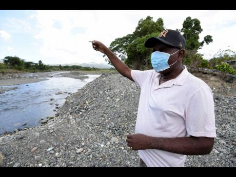 Gauntlet Stewart, a resident of Seaforth Gardens in St Thomas, explains how high the level of the Negro River rose the last time the community got flooded.