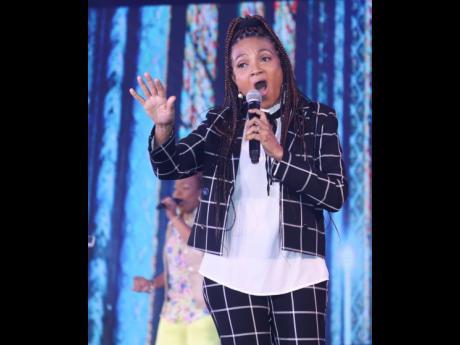 Veteran reggae gospel artiste Carlene Davis performs in a black-and-white chequered pants suit. Veteran reggae gospel artiste Carlene Davis performs in a black-and-white chequered pants suit. Veteran reggae gospel artiste Carlene Davis performs in a black-