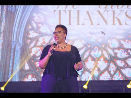 Special guest performer Andrea McCurdy gives a stirring performance during Sagicor Group Jamaica's 50th-anniversary church service.