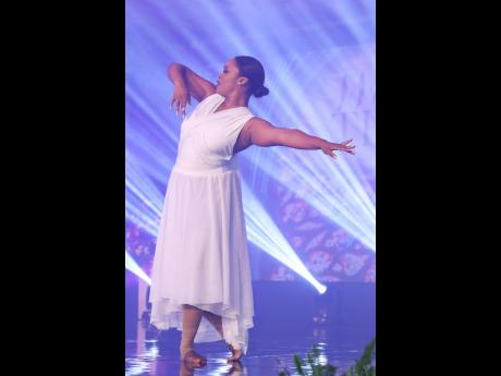 Charissa Clemetson, manager, social and digital media, performs a dance item during the service.  The service featured several outstanding performances from team members, who also led the praise and worship session.Charissa Clemetson, manager, social and d