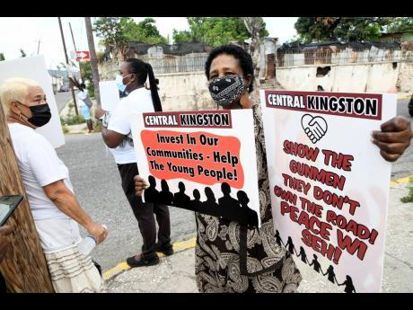 Jennifer Newman, councillor caretaker of the Rae Town division in Kingston Central, protests against gun violence in the constituency on Tuesday.